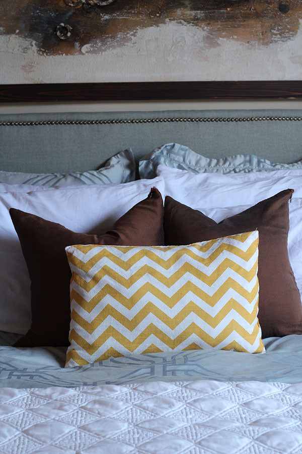 Looking to change up your headboard? Take a look at this awesome DIY Upholstered Headboard with Nailhead Trim! UpcycledTreasures.com