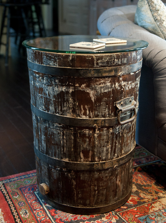 Are you looking for a rustic vibe to ad to your space? Check out some of these great ideas for decorating with Wood Barrels. barrel end table