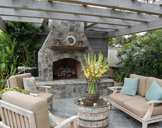 Are you looking for a rustic vibe to ad to your space? Check out some of these great ideas for decorating with Wood Barrels. barrel outside table