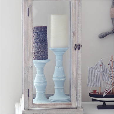 DIY Distressed Pillar Candle Holders! Check out how to create distressed pillar candle holders from some wood candle holders! UpcycledTreasures.com