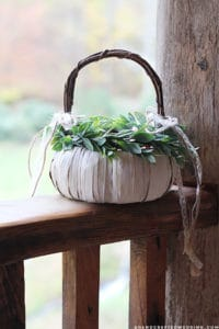 LOVE this idea for a fall wedding! Paint a pumpkin basket white, add twine and ribbon and use it for a flower girl basket. MountainModernLife.com