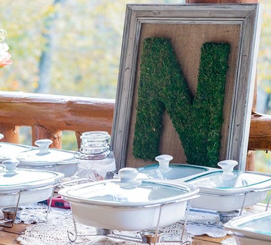 moss monogram letter frame wedding reception mountainmodernlife.com