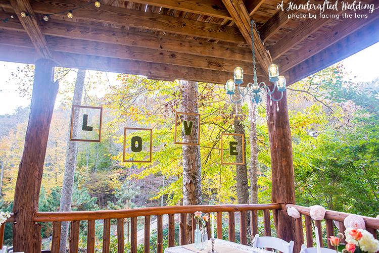 floating-moss-letters-mason-jar-chandelier-wedding-reception-ahandcraftedwedding