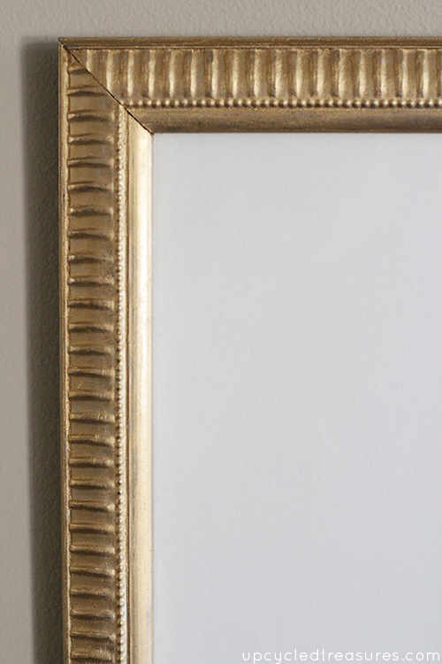 See how to update an old frame using gold Rub'n Buff. This is such an easy way to update an old {or new} art frame! upcycledtreasures.com