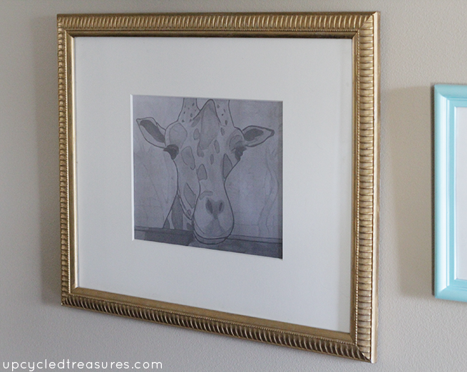See how to update an old frame using gold Rub'n Buff. This is such an easy way to update an old {or new} art frame!