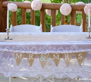 Coffee filter garland behind sweetheart table. mountainmodernlife.com