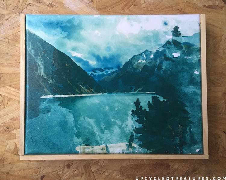 easy way to frame a small canvas using paint sticks. | MountainModernLife.com