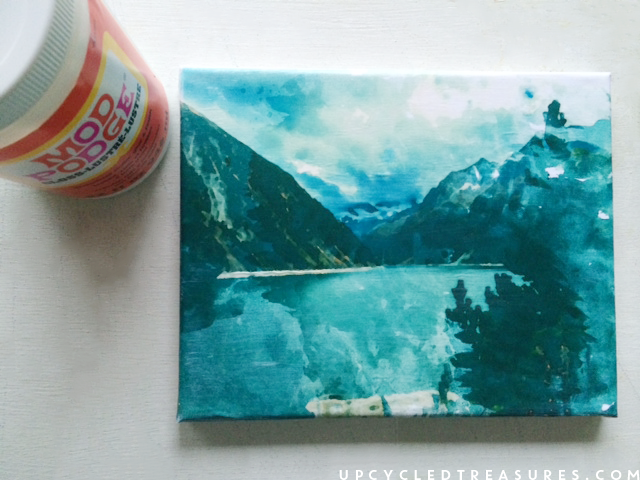 sealing the photo with mod podge. | MountainModernLife.com