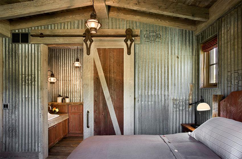 Farmhouse Bedroom with Corrugated Metal Walls | Locati Architects