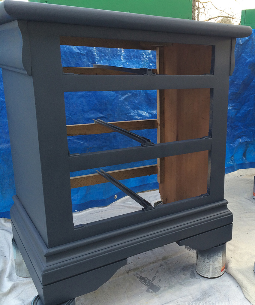 nightstand on paint cans in the middle of being painted. MountainModernLife.com