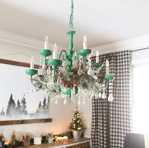 Chandelier with Christmas Greenery