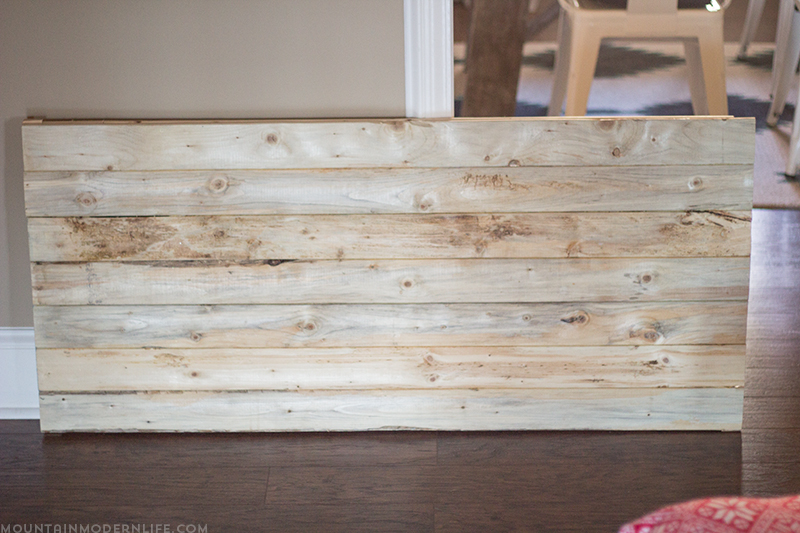 large-handmade-christmas-sign-on-planked-wood-before-mountainmodernlife.com