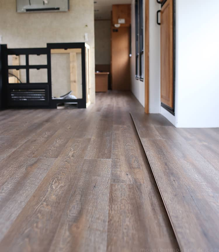 Rustic style plank flooring installed inside the RV | MountainModernLife.com