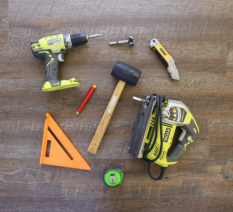 Tools used to install flooring inside RV | MountainModernLife.com