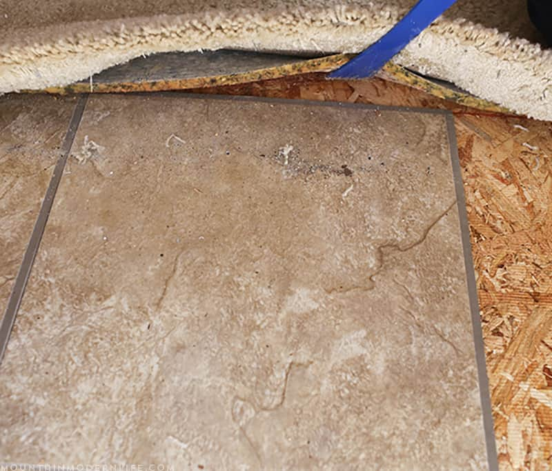 Removing the Carpet and Tile from the RV before replacing the Flooring | MountainModernLife.com