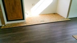 adding-underlayment-to-rv-slide-for-new-flooring-mountainmodernlife.com