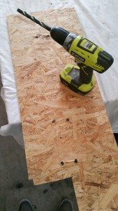 drilling-holes-to-make-it-easier-to-cut-squares-with-jigsaw-mountainmodernlife.com