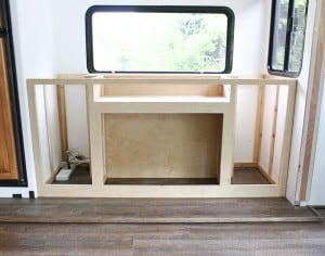 custom built in media cabinet with tv lift and electric fireplace mountainmodernlife.com