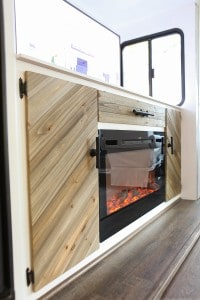 electric-fireplace-installed-inside-motorhome-with-tv-lift-mechanism-mountainmodernlife.com