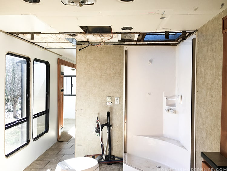 Dealing with a water leak in the ceiling of your motorhome? Come see how we replaced the ceiling panel in our RV. MountainModernLife.com