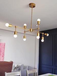 DIY-Brass-Chandelier-Round-Bulbs-velvettoolbox