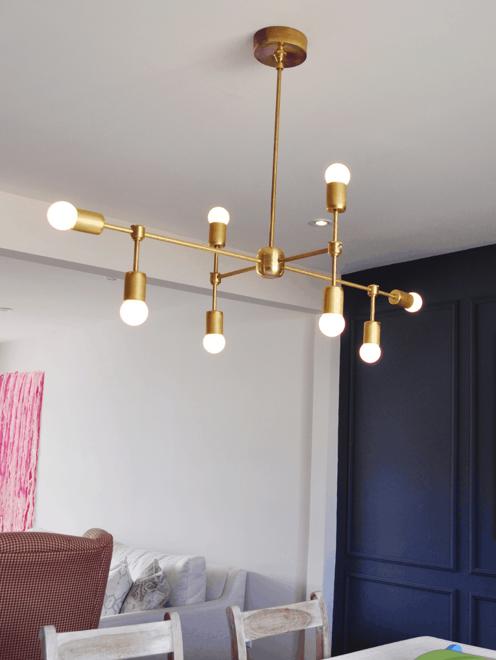 Thinking about making your own light fixture? You've gotta check out these DIY Modern Light Fixtures you won't believe are handmade! Photo: DIY Brass Chandelier with Round Bulbs from VelvetToolbox