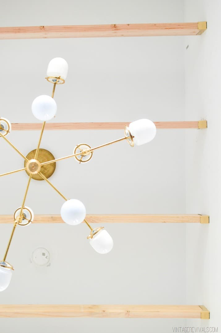 Thinking about making your own light fixture? You've gotta check out these DIY Modern Light Fixtures you won't believe are handmade! Photo: DIY Bent Arm Chandelier from Vintage Revivals