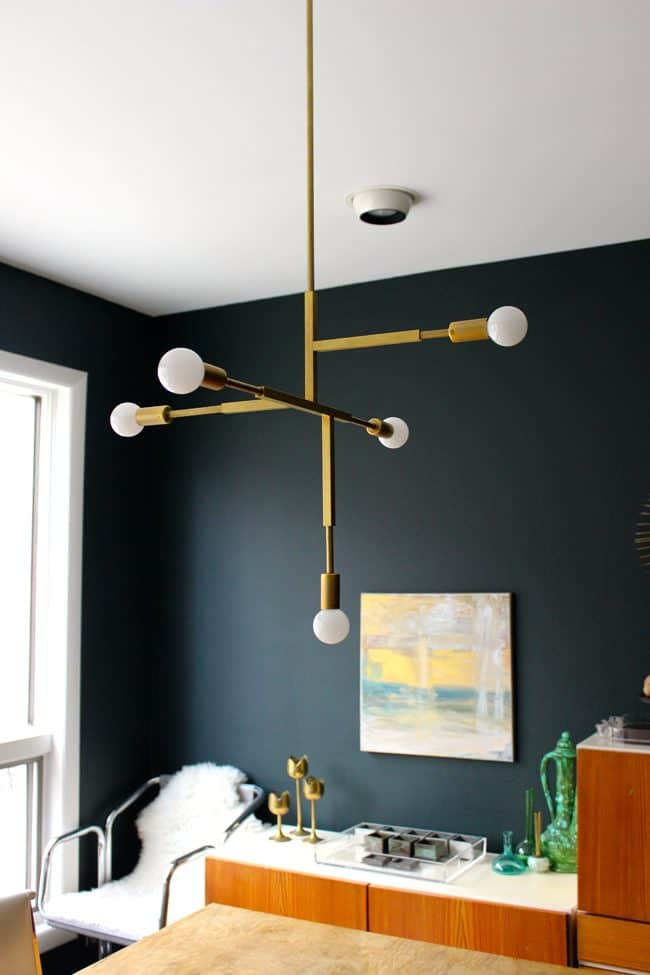 Thinking about making your own light fixture? You've gotta check out these DIY Modern Light Fixtures you won't believe are handmade! Photo: DIY Mid-Century Inspired Light Fixture from ModFrugal