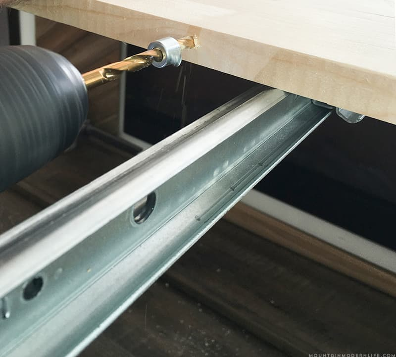 installing wooden dowels to connect table leaves