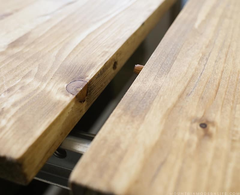 Using wooden dowels to lock table leaf extensions together