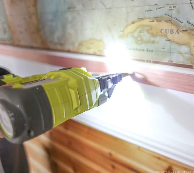 using nail gun to attach map to RV wall