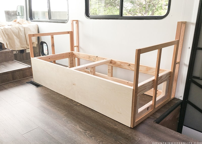 Looking to build a custom seating inside your RV or camper? Come see how we created a custom RV sofa with additional storage space! MountainModernLife.com