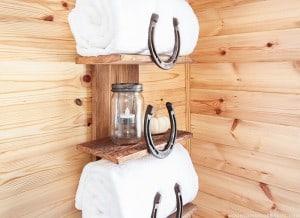 rustic-horseshoe-shelf-for-bathroom-mountainmodernlife-com