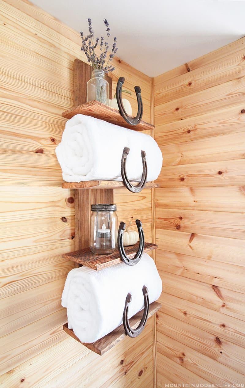 Rustic Bathroom Shelf with Horseshoes | MountainModernLife.com