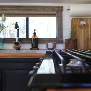 Thinking about updating the kitchen in your camper? Come see how we made a huge impact in our motorhome with our RV kitchen renovation!   MountainModernLife.com #RVreno