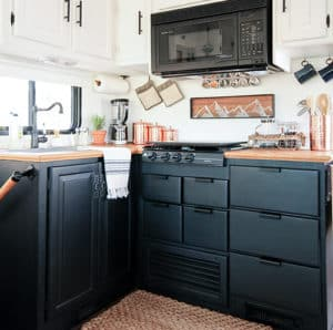 RV Kitchen Remodel with black cabinets   MountainModernLife.com