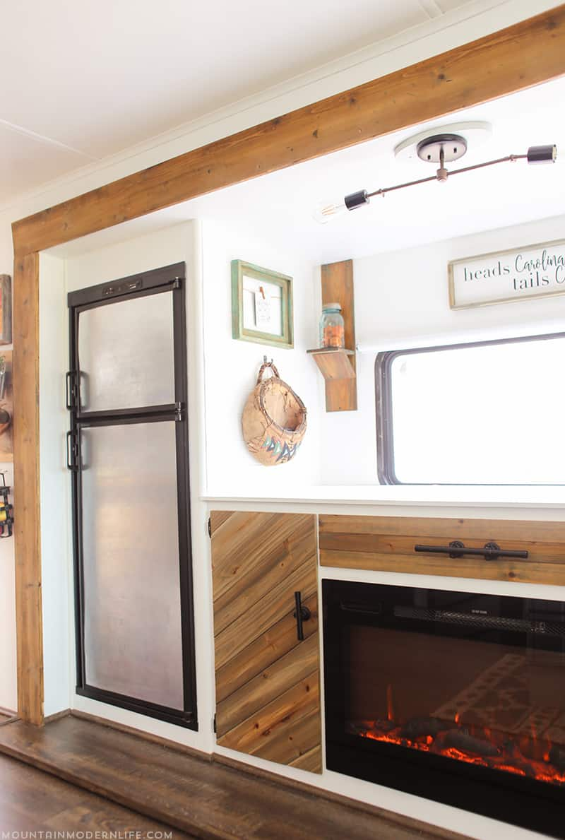 Looking for easy ways to update your RV or camper? See how you can turn your RV fridge into a magnetic dry erase board! MountainModernLife.com