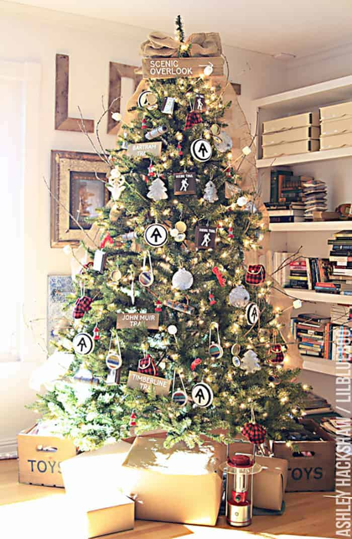 25 of the Most Inspiring Rustic Christmas Trees - Vintage Camping Theme Christmas Tree   LilBlueBoo