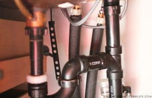 pipes covered with foam insulation in rv during winter mountainmodernlife.com