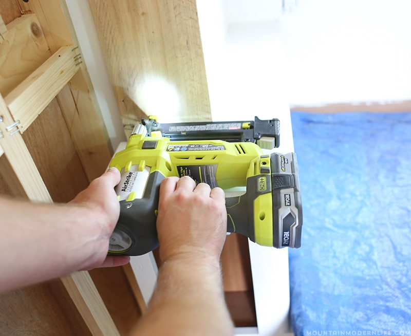 nailing-new-slide-out-trim-in-rv-mountainmodernlife.com
