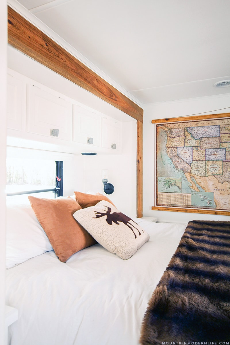 Renovated RV Bedroom with vintage map and moose pillow from MountainMdoernLife.com