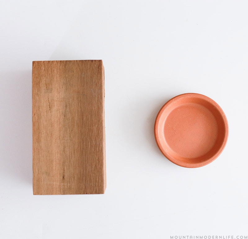 See how easy it is to make these Rustic Modern Candle Holders using scrap wood and terra cotta clay saucers! MountainModernLife.com