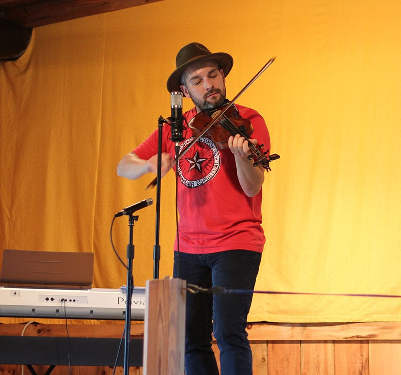 Wyatt Espalin performing in the Music Barn at Mountain View Campground.