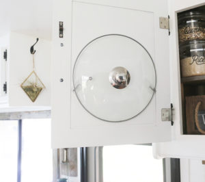 Put lid hanging on cabinet in RV