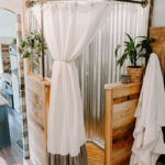 rustic rv bathroom with galvanized metal in shower