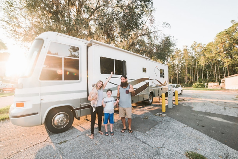 Family in front of renovated motorhome