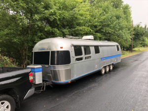 Tour this Renovated Airstream from Trailer Trashin' with Modern Finishes and Tropical Vibes! Featured on MountainModernLife.com