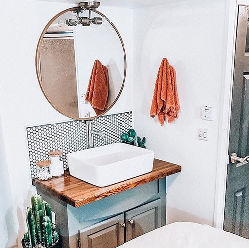 Tour this renovated camper that was transformed by a couple with a passion for international travel! // Photos by ems_traveldiary // Featured on MountainModernLife.com