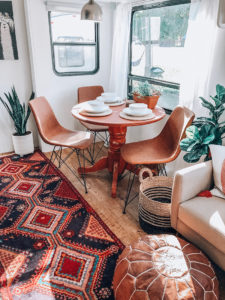 Tour this renovated camper inspired by international travel! // Photos from: ems_traveldiary on Instagram // Featured on MountainModernLife.com