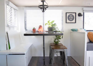 Tour this boho-inspired RV renovated for a family of 4 that's currently for sale! Photos from @CaitiJackson #campervibes #RVreno